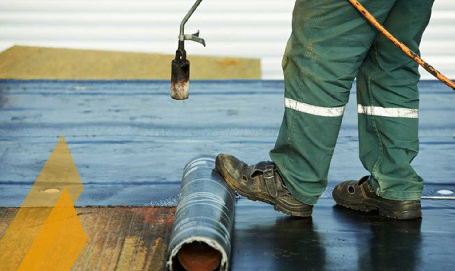 Flat Roofing Company In Edmonton by MD Roofing - roofer laying down flat SBS roofing