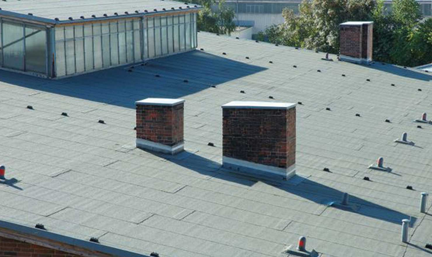 Industrial roof installation in Edmonton by MD Roofing - imaged of slopped industrial roofing