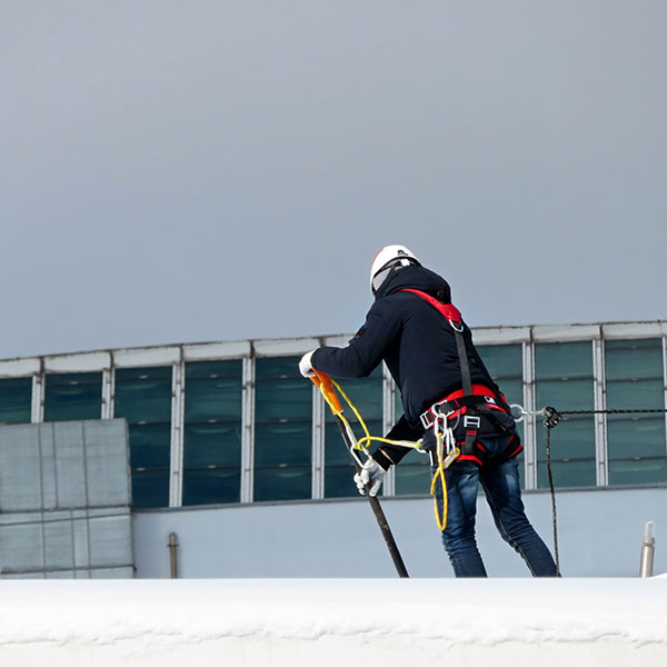 Removing Snow From A Flat Roof Edmonton